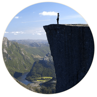 Man standing by cliff