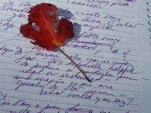 leaf and purple writing