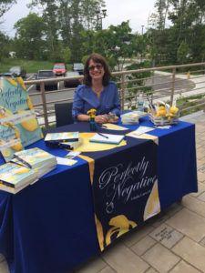 Author Linda Carvelli in a fun and share-friendly photo at her book signing.